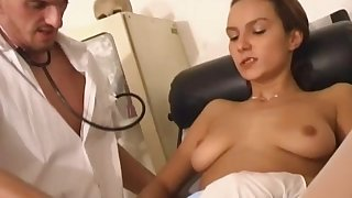 Slutty brunette nurse Petra fucks with a doctor in the office